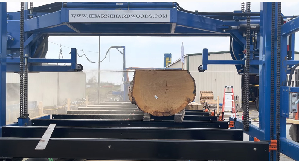 "Meet our new sawmill at Hearne Hardwoods Inc - This mill can handle up to 8 feet wide by 45 feet long and as thin as 7mm (about 3/16"")!"